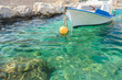 Greek fishing motorboat floating on Kalymnos - 77981013