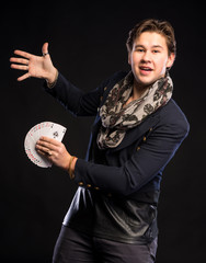 Young magician  with cards