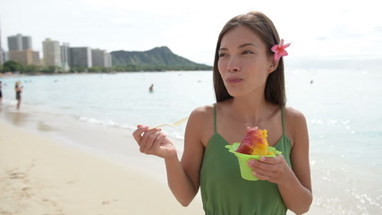 Hawaii woman eating Hawaiian shave ice on Waikiki