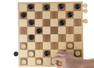 a hand playing on checker board