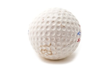 close up image of a dirty golf ball