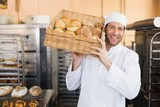 Baker holding basket of bread - 77983676