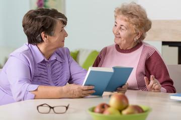Senior women sitting at the table