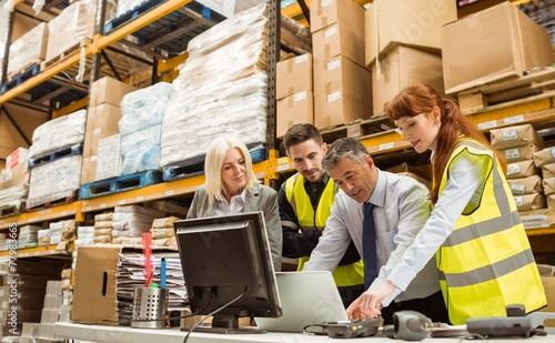 Warehouse managers and worker talking - 77983665