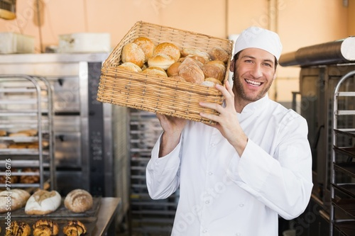 Papiers peints Table preparee Baker holding basket of bread