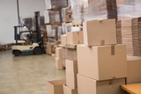 Forklift in a large warehouse - 77984067
