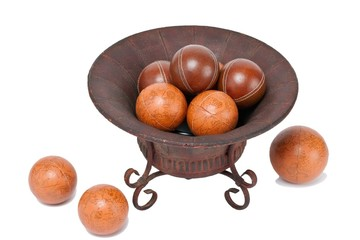 high angle view of metal container with orange and red balls