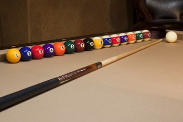 stick on pool table white ball arranged at cushion