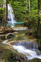 Erawan Waterfall with green forest