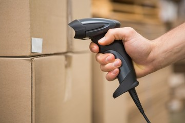 Worker holding scanner in warehouse