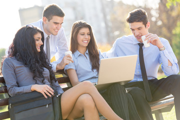 Young Business People On Park Bench