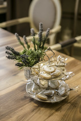 Biscuits with flowers on wooden table