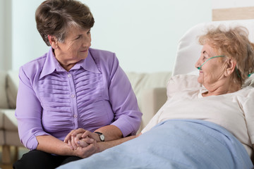 Senior woman caring about sister