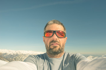 Alpinist taking selfie