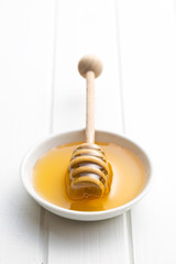 honey dipper in bowl