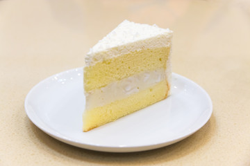 fresh piece of coconut cream cake