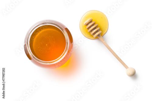 honey dipper and honey in jar - 77987282