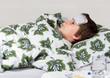 Portrait of sick little boy  in  bed