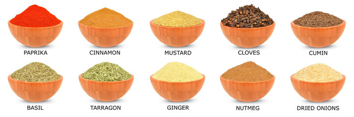 spice in a wooden bowl isolated on white