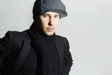 Fashionable Handsome Man in scarf.Boy in hat.spring fashion
