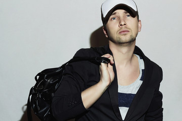 Fashionable Handsome Man with handbag. Stylish Boy