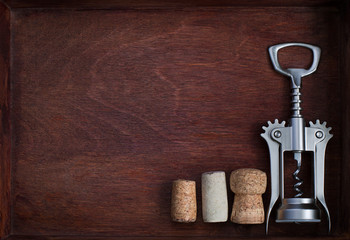 Corkscrew and wine corks into dark box