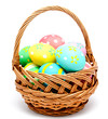 Colorful handmade easter eggs in the basket isolated - 77988436