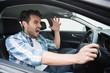 Leinwanddruck Bild - Young man experiencing road rage