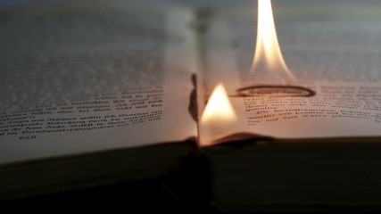 Burning pages of an antique book