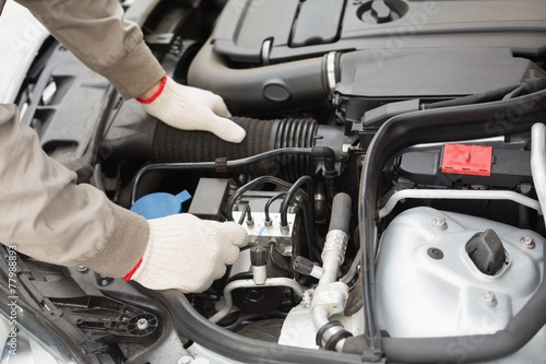 canvas print picture Man checking the engine of his car