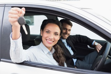 Business team smiling and driving