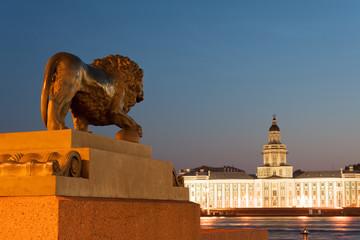 Lion statue looking at Kunstkamera across Neva