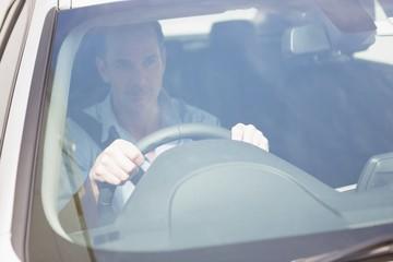 Focused man sitting at the wheel
