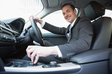 Smiling businessman in the drivers seat