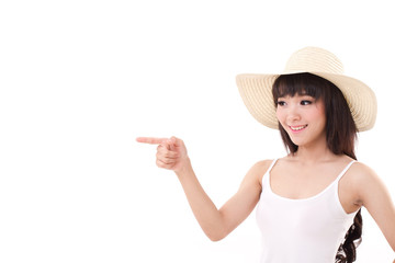 happy, smiling woman pointing finger away to her isolated side