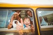 Cute pupils smiling at camera in the school bus - 77990277