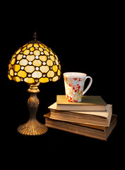reading at night with a tea