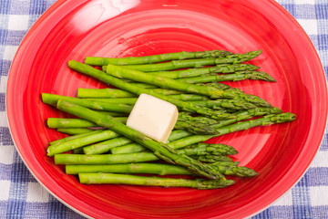 Buttered Asparagus on Red Plate