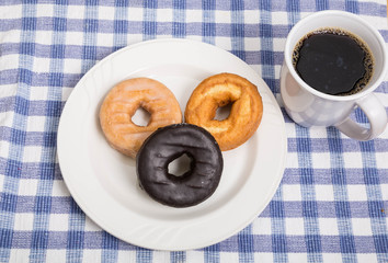 Three Donuts with Cup of Coffee