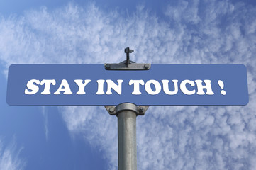 Stay in touch road sign