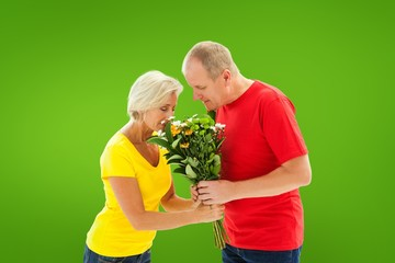 Composite image of mature man offering his partner flowers