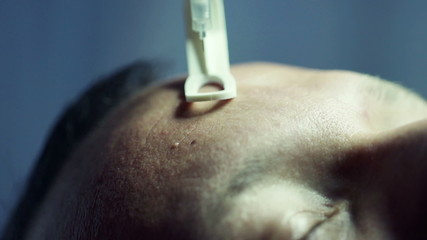Close up of man having a botox injection at beauty salon