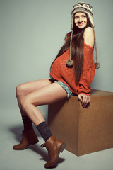 Stylish pregnancy concept. Portrait of happy pregnant woman