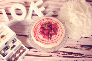 strawberry cake and a box of chocolate treats