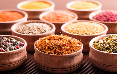 assorted spices in a wooden bowl close-up