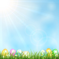Sunny background with grass and eggs