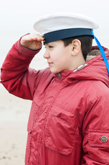 boy in a peaky cap of the sea cabin boy