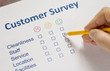 Man completing a customer survey - 77997254