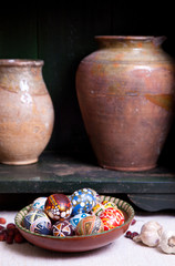 Still life with jug and mix of eggs in the traditional designs