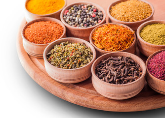 set spices in a wooden bowl close-up